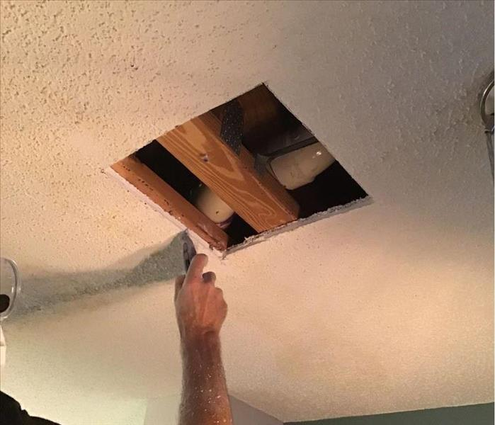 a square hole cut in the ceiling