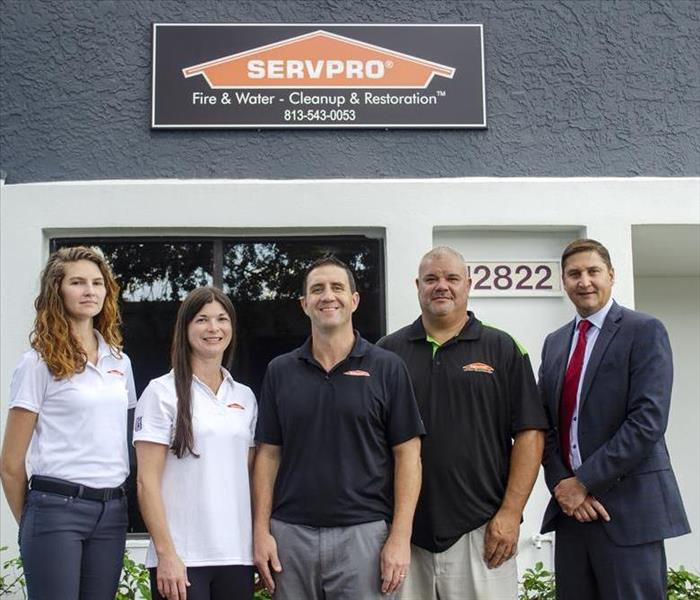 4 SERVPRO team members and local banking manager